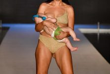 Reactions of people on model walking ramp while breastfeeding baby